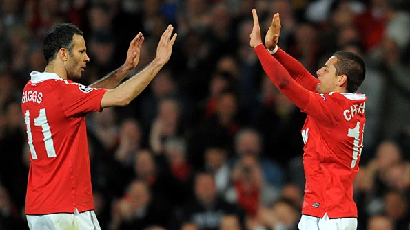 Giggs and Hernandez celebrate after the latter had opened the scoring. Photo: AFP