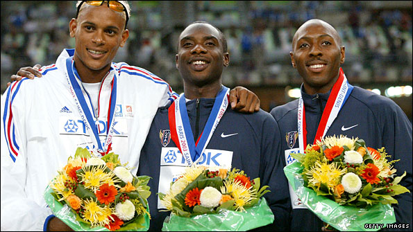 Washington's friend Young (centre) beat him into silver in 2003 but subsequently admitted doping