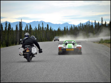 Claudio Von Planta filming the supercar from the back of a motorcycle