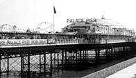 Black and white photograph showing Brighton pier