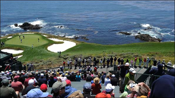 Spectators watch the action on the seventh fairway and green.jpg