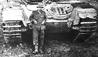 Photo of British tank and crewman in Korea