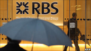 Two men are pictured in a branch of RBS
