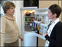 Helen and Kate by a fridge freezer