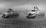 British Sherman tanks advance in North Africa during World War Two