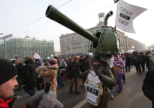 Russian protestor dressed as a tank
