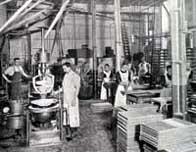 Black and white photograph showing the interior of a confectionery factory