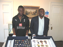 Tottenham Hotspurs Captain, Ledley King and David Lammy MP looking at Spurs Opus