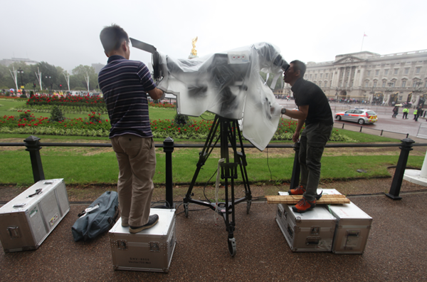 NHK cameramen make final adjustments to a super hi-vision camera used to gather material for special screenings in London, Glasgow and Bradford.