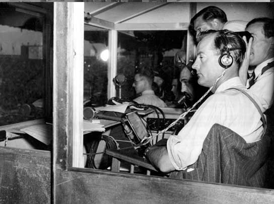 BBC commentators in the commentary box in the Empire Stadium.