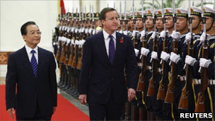 Wen Jiabao and David Cameron walk past troops