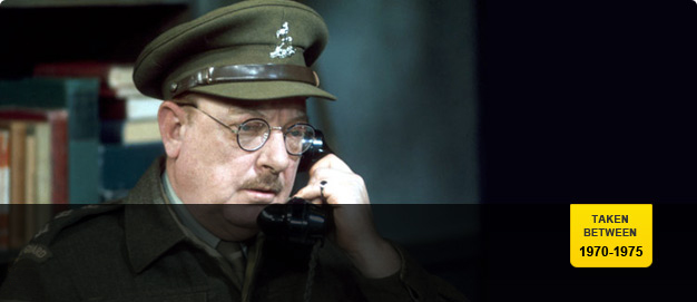 Arthur Lowe as Captain Mainwaring.