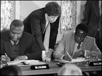 Joshua Nkomo and Robert Mugabe sign a ceasfire at Lancaster House in London 1979