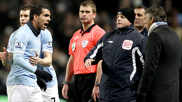Carlos Tevez rows with City boss Roberto Mancini after being substituted against Bolton