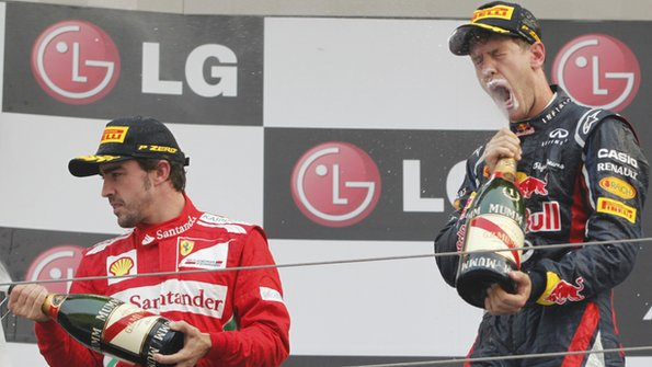 Alonso (left) and Sebastian Vettel