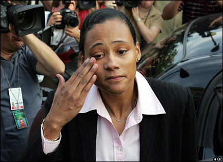 Marion Jones wipes tears from her eyes after admitting perjury at a New York court