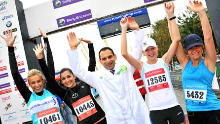 Dr Costas Karageorghis and runners at the end of a race.