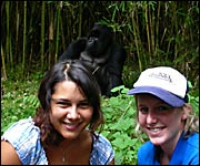 Becky with friend Heather with a silverback gorilla