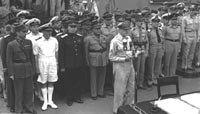 General  Douglas MacArthur opens the Japanese surrender ceremony on the USS Missouri on 2 September 1945. Leading Allied Officers are behind him