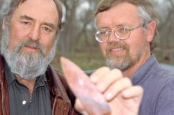 Dennis Stanford and Bruce Bradley with a Clovis spear point