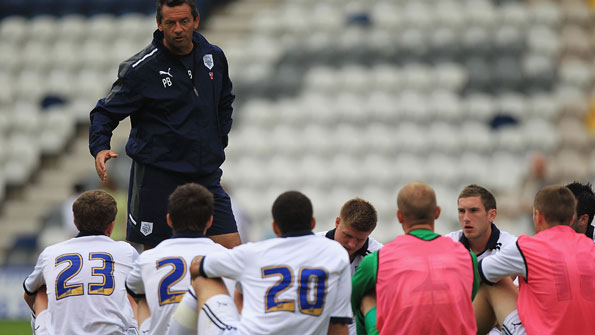 Phil Brown talks to his players after a pre-season friendly.