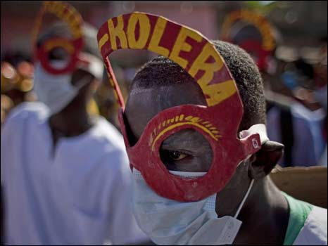 man with mask saying cholera
