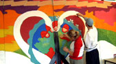 Image of Derry schoolchildren working on a mural