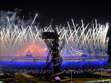 Exterior shot of Olympic Stadium and fireworks during opening ceremony.