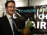 Cllr Joshua Peck with a fairtrade pineapple
