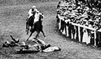 Suffragette Emily Davison throws herself in front of the horse of King George V