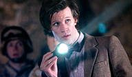 The Eleventh Doctor (Matt Smith) holding a torch