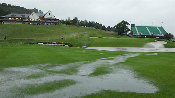 The 18th hole of the Celtic Manor course is submerged in standing water on Sunday morning