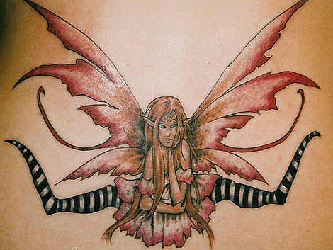 TATTOO DONE IT'S FROM AN AMERICAN AUTHER Of FAIRY PAINTINGS (amy brown).