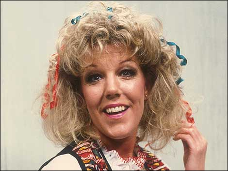 Sue Nicholls as Miss Popov.