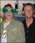 Two men , one wearing comedy glasses