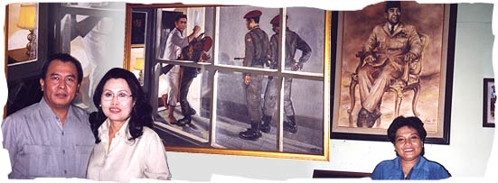 Left-Untung and Amelia Yanni in front of a picture depicting their father being taken. Right-Dr. Ribka Tjiptaning and her late father